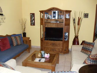 Living room and TV at Caballitos vacation rental villa