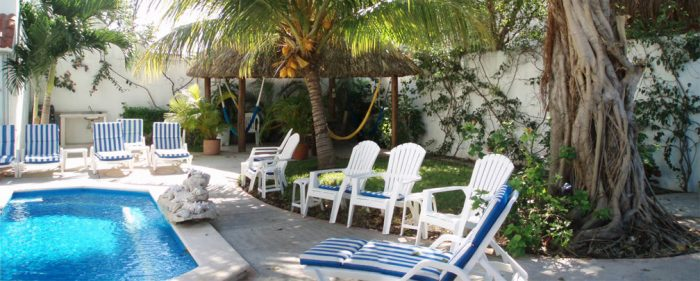 Cozumel garden, palapa and lounge chairs