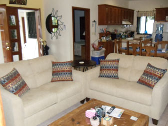 Two sofas in the living area  upstairs