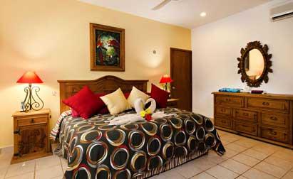 King size bed downstairs at Villa Caballitos