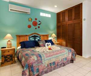 king size bed at Villa Caballitos - Cozumel vacation rental villa