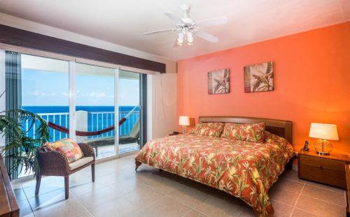 Cozumel beachfront rental condo bedroom and view