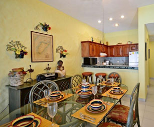 Kitchen and dining area at Cantamar 201, Cozumel vacation rental condo