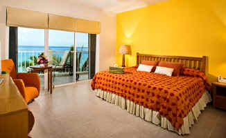 King size bed in the oceanfront Cozumel vacation condo Las Brisas 302
