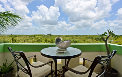 Terrace that faces the jungle in this beachfront Cozumel vacation rental condo